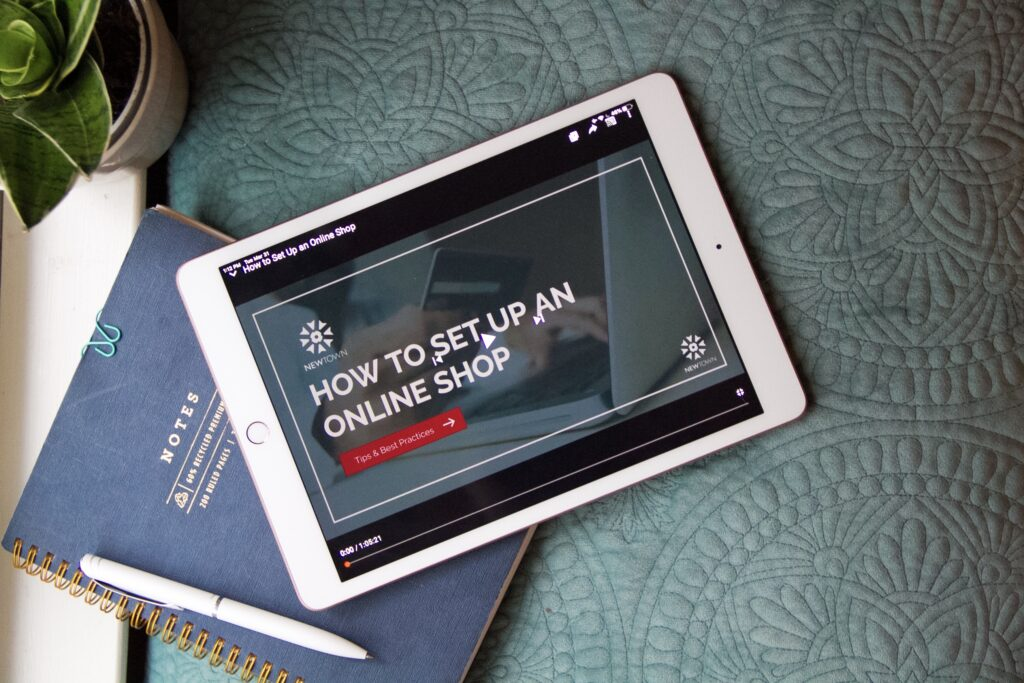 """image showing ipad with a youtube video of an online webinar """"how to set up an online shop"""" by Erica Neubauer"""